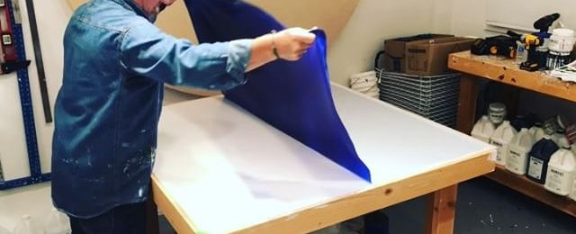 In the studio: Peel and roll day for one of the 7 colors being produced for new projects. This is the last of the luscious blue pieces with many more days of creating paint fabric to go. A long way until this material gets used in an artwork. Thanks for watching. Stay tuned. . . . .