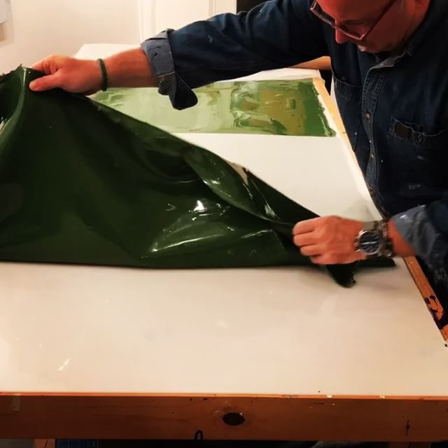 In the studio: Peeling and rolling of one of the 7 colors being produced for new projects. This is the last of the green pieces. There are many more days of creating paint fabric until the material gets used in artwork. Thanks for watching. Stay tuned. . . . .