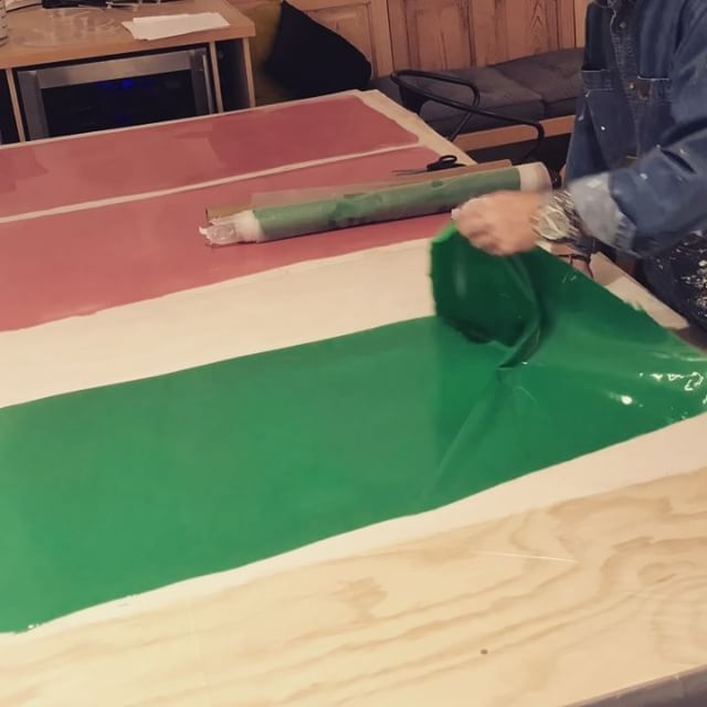 In the studio: Peeling and rolling two of the 8 colors being produced for new projects. This timelapse is the last of the green and pink pieces. There are a few more days of creating paint fabric until the material gets used in artwork. Thanks for watching. Stay tuned. . . .