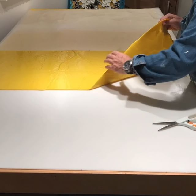 In the studio: Peeling and rolling yellow and green paint for a rather oversized project. Timelapse video includes me wrestling with a sheet of green that escaped. Yep still a few more days of creating paint fabric until the material gets utilized in artwork. Thanks for watching. Stay tuned. . . . .
