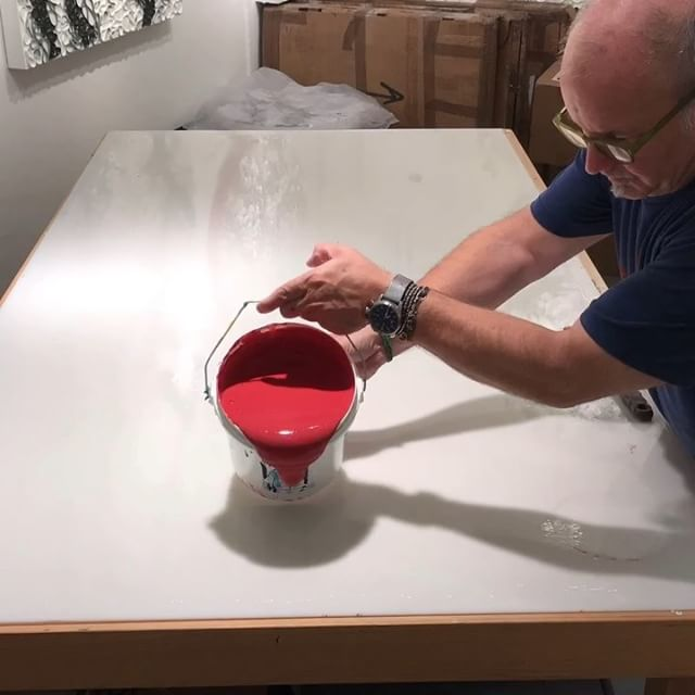 In the studio: Timelapse video of lots of rich red and some pink too. Paint pour and paint skin production is in full gear. Two more colors to go to the end of this round of pouring gallons of @goldenpaints gels and paint on every available flat surface. Stay tuned.... . . . .