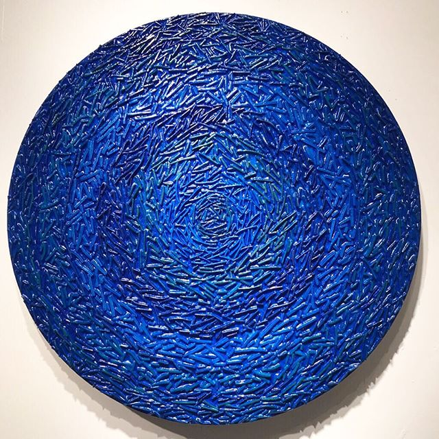 "Wintertime studio experiments: My translucent blue 30"" round experiment is on the wall for a quick look. This is a piece where I played with layers upon layers of cobalt blue... Experimenting with color shifts and translucent glazes. Learned a lot with this piece that started out white with a very vibrant colors in the bands of textures. Goal was to get  the underlying color bands to recede.  It's been a fun month playing with glazes on top of an assortment of previously created pieces. . Come check out this and other experiments this Saturday from 12 to 5pm. Artists Working open house event at the ICB in Sausalito . Over 40 art studios open. . . . . . . ."