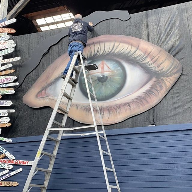 "Definitely not in the studio today! Putting some oversized eyebrows on some oversized eyes. What else is there to do on a rainy San Fracisco Sunday when almost everything is closed. This is a  collab with @3nolam on a mural project in San Francisco ""See the World"" The top 175 travel destinations (and a few random one) are part of the piece. Stay tuned for some more progress pics. . . . . . . ."
