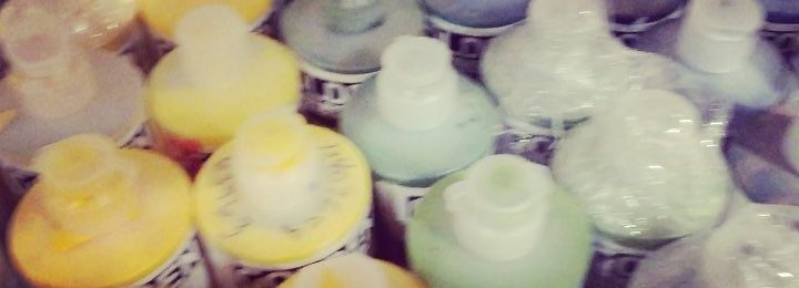 In the studio: piles of supplies and lots and lots of liquid acrylics are in the studio and ready to