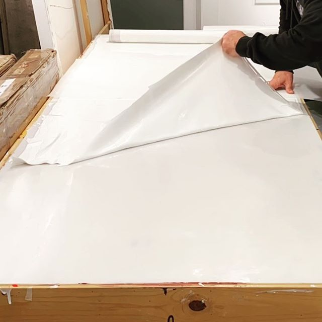 In the studio: starting 2020 by cutting and rolling titanium white acrylic paint skins. Next step for creating materials for upcoming commissions. Will be making lots of these materials in coming weeks. Stay tuned more paint slinging to come. Happy New Year's Day . .