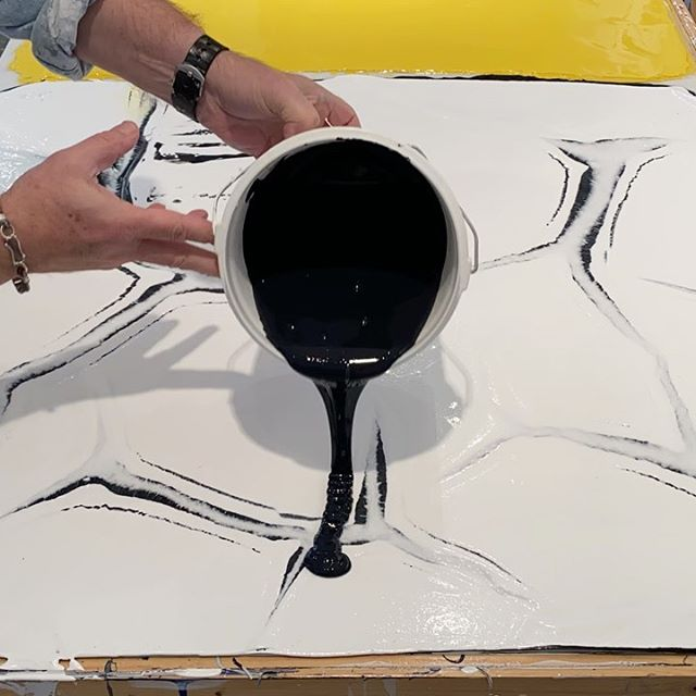 In the studio: Tossing around a half gallon of carbon black on top of last weeks titanium white  acrylic paint plus some white gel over a layer of black. Back to the basic steps in material making. This pour is number two of three layers for this project. Next layer is back to yellow. Each layer takes about 4 to 5 days to dry. Stay tuned more paint slinging. Happy Saturday from . .